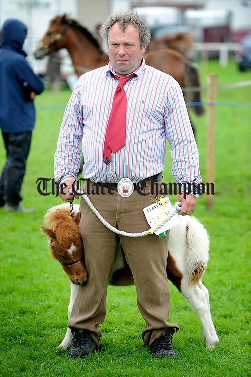 Austin Colton of Tullamore with his miniature pony at the Clare County Show in Ennis. Photograph by John Kelly.
