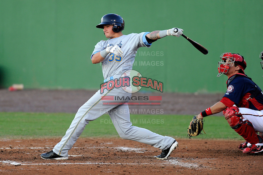 Infielder/DH Joe Maloney (35) of the Myrtle Beach Pelicans bats in a game against the Potomac Nationals on Monday, June 24, 2013, at G. Richard Pfitzner Stadium in Woodbridge, Virginia. The Potomac catcher is Cole Leonida. Myrtle Beach won, 3-2. (Tom Priddy/Four Seam Images)