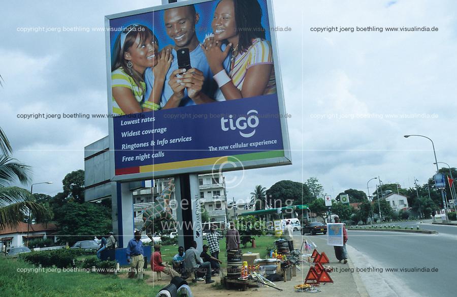 Tanzania, Dar es Salam, ad for mobile phone company Tigo on street / Tansania, Dar es Salam, Werbeschild der Mobiltelefongesellschaft TIGO