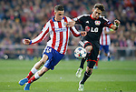 Atletico de Madrid's Jose Maria Gimenez (l) and Bayer 04 Leverkusen's Arda Turan during Champions League 2014/2015 match.March 16,2015. (ALTERPHOTOS/Acero)