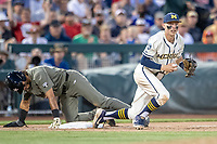Michigan Wolverines third baseman Blake Nelson (10) after tagging out Vanderbilt Commodores base runner Austin Martin (16) during the eighth inning of Game 1 of the NCAA College World Series Finals on June 24, 2019 at TD Ameritrade Park in Omaha, Nebraska. Michigan defeated Vanderbilt 7-4. (Andrew Woolley/Four Seam Images)