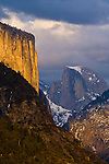 Sunset light on El Capitan and storm clouds over Half Dome and Yosemite Valley, Yosemite National Park, California
