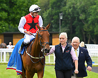 Winner of The Molson Coors Handicap (Class 6) Glamorous Dream ridden by David Probert and trained by Ronald Harris  is led into the winners enclosure during Afternoon Racing at Salisbury Racecourse on 12th June 2018