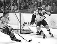 Seals Bert Marshall and Doug Roberts against Pittsburg Pengujin Nick Harbaruk..(1971 photo/Ron Riesterer)