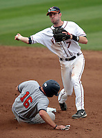 Virginia infielder Branden Cogswell (7) tries for the double play at first over Bucknell catcher Justin Meier (16) during the game Friday at Davenport Field in Charlottesville, VA. Photo/The Daily Progress/Andrew Shurtleff