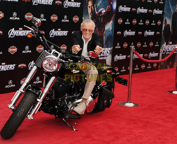 "Stan Lee.""Marvel's The Avengers"" World Premiere held at the El Capitan Theatre, Hollywood, California, USA..April 11th, 2012.full length black suit jacket white shirt beige trousers sitting motorbike motorcycle bike hands tinted glasses .CAP/ROT/TM.©Tony Michaels/Roth Stock/Capital Pictures"