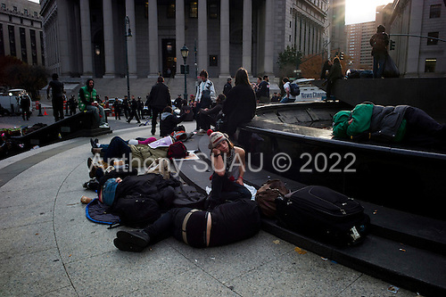 New York, New York<br /> November 15, 2011<br /> <br /> After the police clear Zuccotti Park many of the evicted and exhausted &quot;Occupy Wall Street&quot; protesters, reconvened in Foley Square.<br /> <br /> The protesters then marched to Juan Pablo Duarte Square at Canal and 6th Ave and final back to Zuccotti Park to wait a court order to reenter the park.