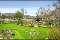 BNPS.co.uk (01202)558833<br /> Pic:    Savills/BNPS<br /> <br /> The garden of the main house.<br /> <br /> A country estate that has its own farm, tea rooms and glamping business in the heart of the Lake District has gone on market for those looking to escape the rat race.<br /> <br /> Backside Farm sits on the banks of Ullswater - the second largest lake in the Cumbrian National Park - and has one mile of water access as well as stunning views of the mountains. <br /> <br /> The outgoing owners have been on the 195 acre estate for over a decade and in that time they have renovated the large five bedroom farmhouse.<br /> <br /> They also set up the tea rooms and two holiday rental cabins and have established them as a business.