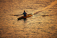Woman sculling on the Charles River.