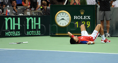 18.09.2011 Davis Cup World Group Tennis Semi Final from Belgrade. Serbia v Argentina. Picture shows Serbian Player Novak Djokovic lays on the ground after a back injury. Djokovic played against Juan Martin Del Potro of Argentina.