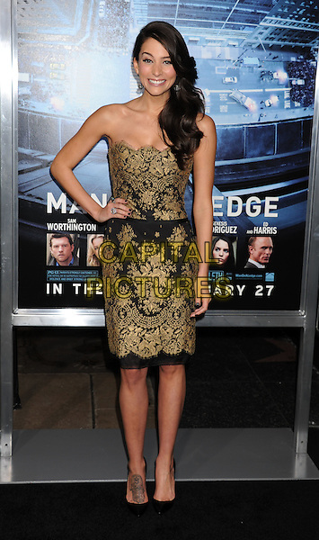 Genesis Rodriguez.L.A. Premiere of 'Man on a Ledge' held at The Grauman's Chinese Theatre in Hollywood, California, USA..January 23rd, 2012.full length dress black lace gold strapless hand on hip.CAP/ROT/TM.©Tony Michaels/Roth Stock/Capital Pictures