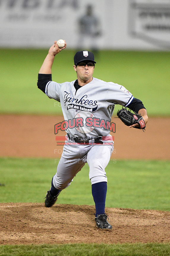 Staten Island Yankees pitcher Joe Harvey (52) delivers a pitch during a game against the Batavia Muckdogs on August 7, 2014 at Dwyer Stadium in Batavia, New York.  Staten Island defeated Batavia 2-1.  (Mike Janes/Four Seam Images)