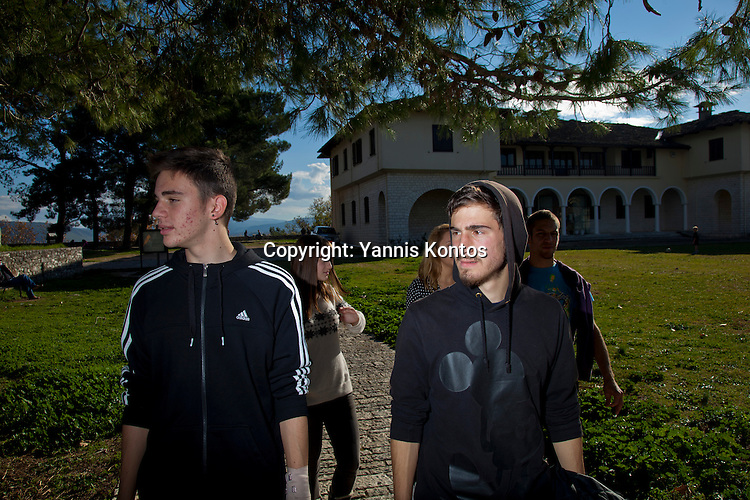 Greek students Konstantinos Vartziotis,18,(L) and Dinos Athanasiou,18, relax from their lessons near by the Ioannina lake.