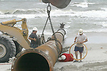 06/11/05....Gary Wilcox/staff......Workers from The Bean Corp.was laying pipes on Jacksonville Beach too start doing  renourishment on  Jacksonville Beach last June. (06/11/05