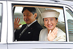 Japan's new Emperor Naruhito and new Empress Masako wave from their vehicle near the Imperial Palace in Tokyo, Japan on May 1, 2019, the first day of the Reiwa Era. (Photo by MATSUO.K/AFLO)