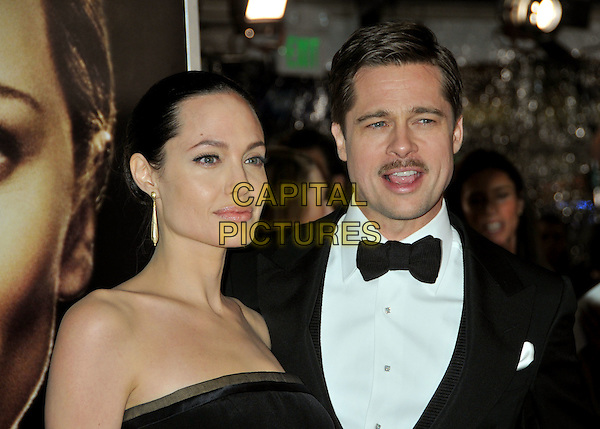 "ANGELINA JOLIE & BRAD PITT.""The Curious Case of Benjamin Button"" Los Angeles Premiere at Mann's Village Theatre, Westwood, California, USA..December 8th, 2008.headshot portrait strapless dangling gold earrings bow tie black moustache mustache facial hair mouth open  .CAP/ADM/BP.©Byron Purvis/AdMedia/Capital Pictures."