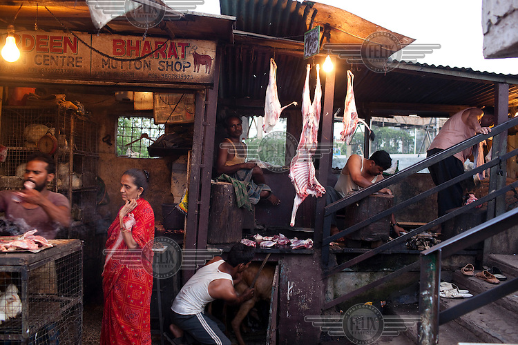 A butcher selling mutton in Dharavi slum.