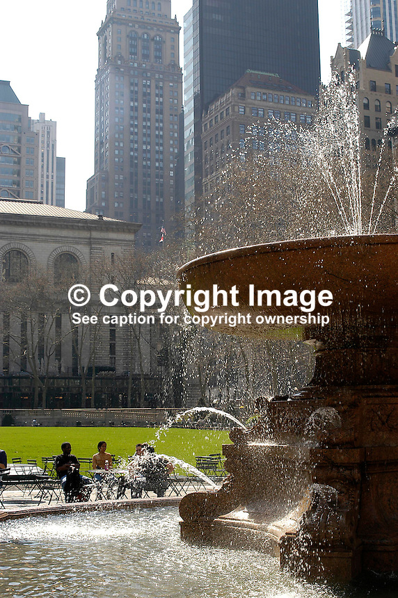 New Yorkers sit in the sunshine in Bryant Park, Manhatten, New York, USA. Ref: 200304160007...Copyright Image from Victor Patterson, 54 Dorchester Park, Belfast, UK, BT9 6RJ..Tel: +44 28 9066 1296.Mob: +44 7802 353836.Voicemail +44 20 8816 7153.Skype: victorpattersonbelfast.Email: victorpatterson@mac.com.Email: victorpatterson@ireland.com (back-up)..IMPORTANT: If you wish to use this image or any other of my images please go to www.victorpatterson.com and click on the Terms & Conditions. Then contact me by email or phone with the reference number(s) of the image(s) concerned.