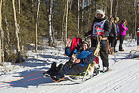 Ralph Johannessen and team run past spectators on the bike/ski trail during the Anchorage ceremonial start during the 2014 Iditarod race.<br /> Photo by Britt Coon/IditarodPhotos.com