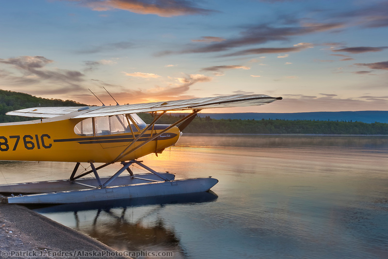 Morning sunrise over Naknek lake and a super cub bush plane on floats along the shore, Katmai National Park, southwest, Alaska.
