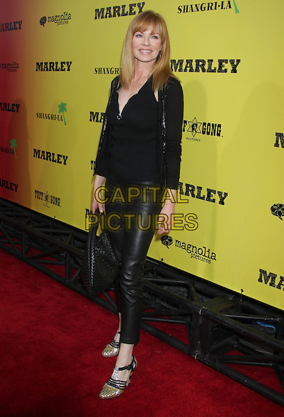Marg Helgenberger.'Marley' Los Angeles Premiere held at Arclight Cinemas, Hollywood, California, USA..April 17th, 2012.full length leather trousers top black.CAP/ADM/RE.©Russ Elliot/AdMedia/Capital Pictures.