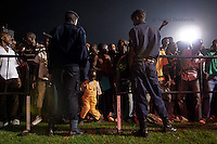 People dance while waiting for president Paul Kagame to come to the announcment of partial presidential election results at Amahoro stadium, Kigali, Rwanda. August 9 2010