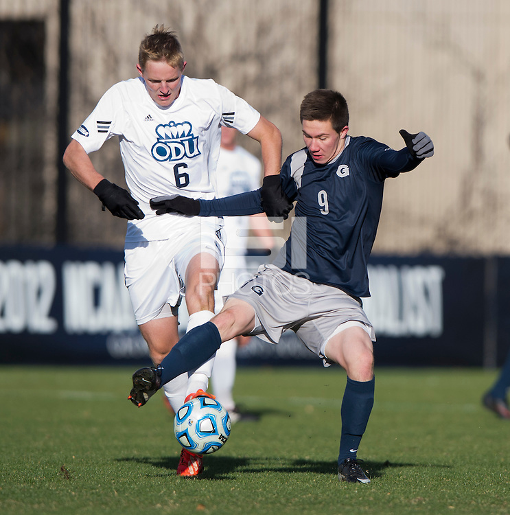 Alex Muyl (9) of Georgetown fights for the ball with Ryan Condotta (6) of Old Dominion during the second round of the NCAA tournament at Shaw Field in Washington, DC. Georgeotown defeated Old Dominion, 3-0.