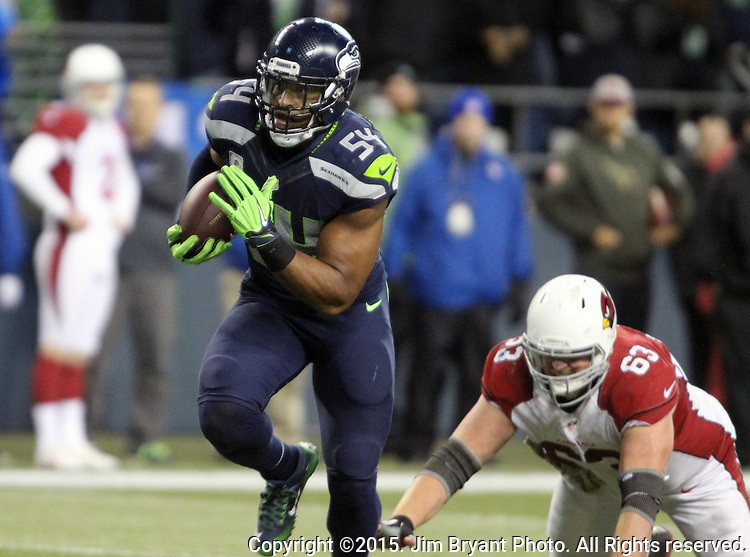 Seattle Seahawks  linebacker Bobby Wagner returns Arizona Cardinals quarterback Carson Palmer's fume 22 yard for a touchdown at CenturyLink Field in Seattle, Washington on November 15, 2015. The Cardinals beat the Seahawks 39-32.   ©2015. Jim Bryant photo. All Rights Reserved.