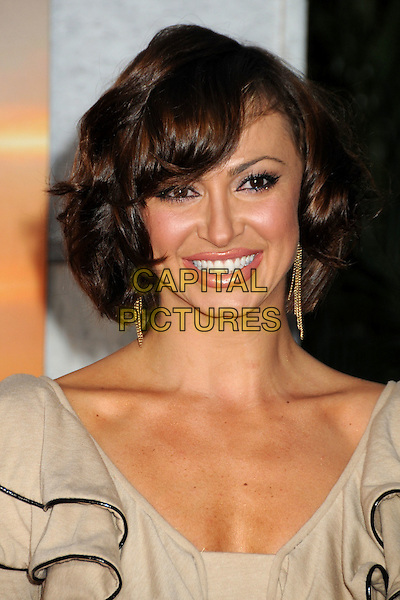 "KARINA SMIRNOFF .""The Last Song"" World Premiere held at Arclight Cinemas, Hollywood, California, USA, 25th March 2010..arrivals portrait headshot smiling beige ruffles ruffle black trim  gold dangly earrings .CAP/ADM/BP.©Byron Purvis/AdMedia/Capital Pictures."