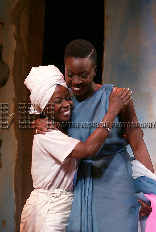 Akosua Busia and Danai Gurira onstage during the 'Eclipsed' broadway opening night curtain call at The Golden Theatre on March 6, 2016 in New York City.