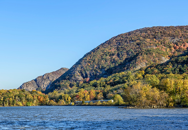 An early morning view of Bull Hill (also known as Mount Taurus) and Breakneck Ridge (behind and to the left), at Cold Spring, NY, in autumn