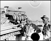 BNPS.co.uk (01202 558833)Pic:    Pen&Sword/BNPS<br /> <br /> Crew members standing next to their Panzer tank out in the open desert.  Bottles of water can be seen on the turret side.<br /> <br /> Fascinating rare photos of Rommel's feared Afrika Korps which terrorised the Allies in the desert have come to light in a new book.<br /> <br /> Under the direction of legendary German commander Field Marshal Erwin Rommel, who was nicknamed the Desert Fox, the corps were recognised as a superb fighting machine.<br /> <br /> They achieved their greatest triumph when they outmanoeuvred the British at the Battle of Gazala in June 1942 which led to them capturing Tobruk in Libya.<br /> <br /> But they were ultimately defeated in the iconic Battle of Alamein when they succumbed to an offensive led by Field Marshal Bernard Montgomery.