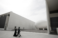 Qatar - Doha - Education City. Students walking by the University building.