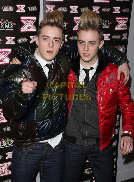 JOHN & EDWARD (GRIMES).aka Jedward .Photocall and Live show at Talk Talk Headquarters, London, .November 30th 2009..half length twins hair quiff black red coat puffa puffer around shoulder black tie jacket x factor coats jeans finger pointing family .CAP/ROS.©Steve Ross/Capital Pictures.