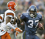 Seattle Seahawks' running back Shaun Alexander rushes against the Cleveland Browns on Sunday, Nov. 30, 2003 at  QWEST Field in Seattle. Jim Bryant Photo. ©2010. All Rights Reserved.