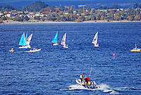 Yachts, sailing boats, Lake Taupo, New Zealand, with Taupo, the township, in the background. 20104145420..Copyright Image from Victor Patterson, 54 Dorchester Park, Belfast, United Kingdom, UK. Tel: +44 28 90661296. Email: victorpatterson@me.com; Back-up: victorpatterson@gmail.com..For my Terms and Conditions of Use go to www.victorpatterson.com and click on the appropriate tab.