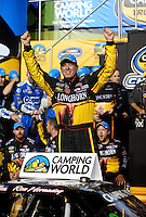 Nov. 20, 2009; Homestead, FL, USA; NASCAR Camping World Truck Series driver Ron Hornaday celebrates as the 2009 truck series champion following the Ford 200 at Homestead Miami Speedway. Mandatory Credit: Mark J. Rebilas-