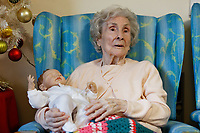 Pictured: Sandra Morgan holds a baby doll. Thursday 12 December 2019<br /> Re: Realistic looking baby dolls used for therapy at Cwrt Myton care home in Abertillery south Wales, UK.