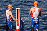 20 JUL 2013 - HAMBURG, GER - Jonathan Brownlee (GBR) (left) and Alistair Brownlee (GBR) (right) of Great Britain prepare for the start of the elite men's ITU 2013 World Triathlon Series round in the Altstadt Quarter in Hamburg, Germany (PHOTO COPYRIGHT © 2013 NIGEL FARROW, ALL RIGHTS RESERVED)