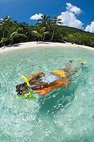 Snorkeler Jen Gibbud in clear calm water<br /> Salomon Beach.Virgin Islands National Park.St. John, U.S. Virgin Islands