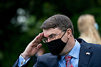 United States Secretary of Veterans Affairs (VA) Robert Wilkie, salutes while wearing a protective mask during a Rolling to Remember ceremony honoring the nation's veterans and prisoners of war/missing in action (POW/MIA) in Washington, D.C., U.S., on Friday, May 22, 2020. US President Donald J. Trump didn't wear a face mask during most of his tour of Ford Motor Co.'s ventilator facility Thursday, defying the automaker's policies and seeking to portray an image of normalcy even as American coronavirus deaths approach 100,000. <br /> Credit: Andrew Harrer / Pool via CNP/AdMedia