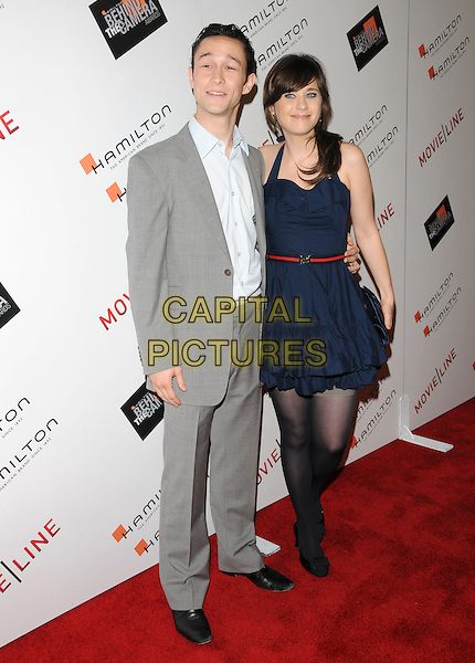 JOSEPH GORDON-LEVITT & ZOOEY DESCHANEL .at The Movieline.com Presentation of The 4th Annual Hamilton Behind the Camera Awards held at The Highlands in Hollywood, California, USA, November 8th 2009..full length grey gray suit navy blue dress halterneck ruffle red waist belt black shoes bows tights stockings clutch bag .CAP/RKE/DVS           .©DVS/RockinExposures/Capital Pictures.