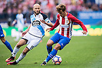 Antonie Griezmann of Atletico Madrid fights for the ball with Laure of Deportivo de la Coruna during their La Liga match between Atletico Madrid and Deportivo de la Coruna at the Vicente Calderon Stadium on 25 September 2016 in Madrid, Spain. Photo by Diego Gonzalez Souto / Power Sport Images