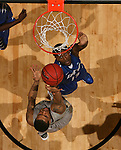 SIOUX FALLS, SD - MARCH 10:  Duke Mondy #10 from Oakland lays the ball up over Luis Jacobo #13 from IPFW in the second half of their game during the 2013 Summit League Basketball Tournament Sunday evening in Sioux Falls, SD.  (Photo by Dave Eggen/Inertia)