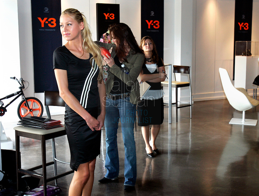 Tennis star Anna Kournikova waits to begin a round of interviews during an appearance at the Y-3 store in The Shops Around Lenox in Atlanta, Ga. on Friday afternoon, May 5, 2006. She was in town for the USTA Mercedes Benz Classic at the Arena at Gwinnett Center.