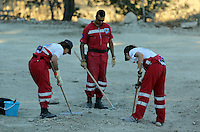Pictured: Hellenic Red Cross volunteers searching at the farmhouse site in Kos, Greece. Sunday 09 October 2016<br />