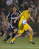 U.S. Open Cup Round of 16: Columbus Crew's Eddie Gaven (12) shields the ball from DC United's Facundo Erpen (5). DC United defeated the Columbus Crew in overtime 2-1, Tuesday, August 1, 2006, at Maryland Soccerplex.