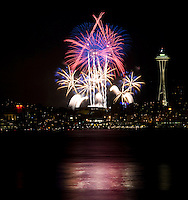 Photo by Stephen Brashear.Fireworks over Seattle as seen from Seacrest Park Friday July 4, 2008.