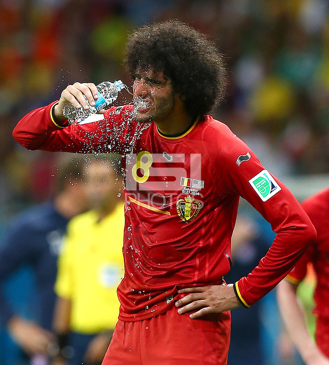 Marouane Fellaini of Belgium pours water over his face to cool down