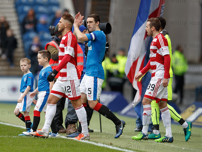 Rangers mascots and captains as the teams take to the field